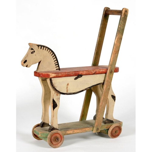 369 - <p>AN EARLY 20TH C PAINTED PUSH ALONG TOY, 57CM H</p>...
