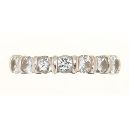 39 - <p>A DIAMOND RING, THE SEVEN SEMI FLUSH SET BRILLIANT CUT DIAMONDS 0.85CT APPROX, J COLOUR, VS2/SI1 ...