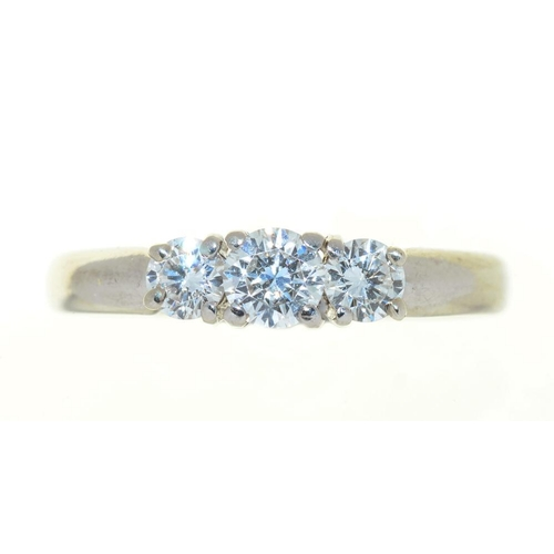52 - <p>A THREE STONE DIAMOND RING, THE BRILLIANT CUT DIAMONDS 0.55CT, H COLOUR, VS1 CLARITY APPROX, IN P...