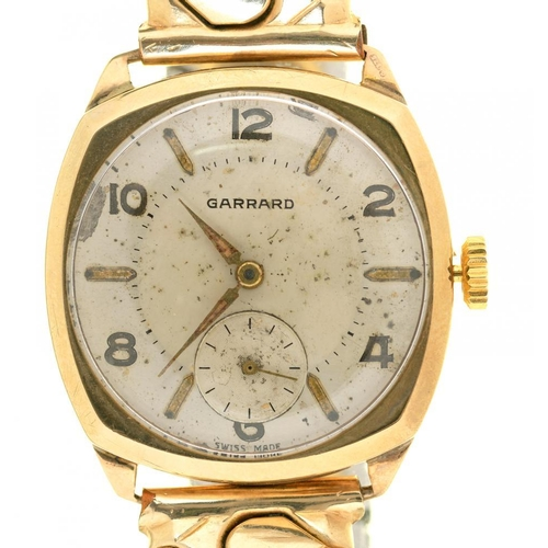 14 - <p>A GARRARD GOLD GENTLEMAN'S WRISTWATCH, GOLD PLATED FLEXIBLE BRACELET, CUSHION SHAPED DIAL 27MM AP...