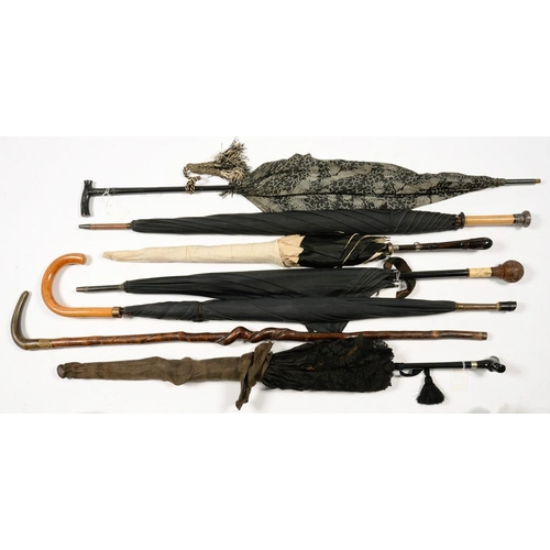 342 - <p>SIX VARIOUS EBONY HANDLED SILVER MOUNTED AND OTHER PARASOLS AND UMBRELLAS, EARLY 2OTH C AND LATER...