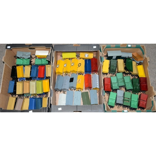 504 - <p>APPROXIMATELY SIXTY O-GAUGE RAILWAY VANS AND SIDE TIPPING WAGONS</p>...