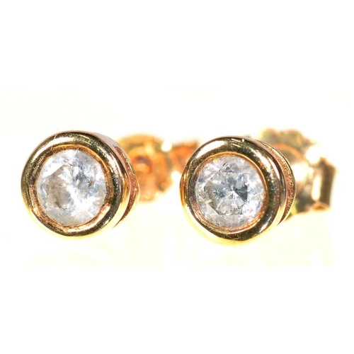 63 - <p>A PAIR OF DIAMOND SOLITAIRE EAR STUDS, DIAMONDS 0.25CT APPROX TOTAL, SET IN GOLD</p><p></p>...