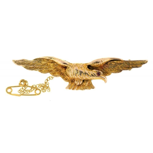 8 - <p>A GOLD EAGLE BROOCH, WITH GARNET EYE, MARKED 9CT, 8G</p><p></p>...