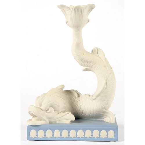 172 - <p>A WEDGWOOD BLUE AND WHITE JASPER WARE DOLPHIN CANDLESTICK, 24CM H, IMPRESSED AND GILT PRINTED MAR...