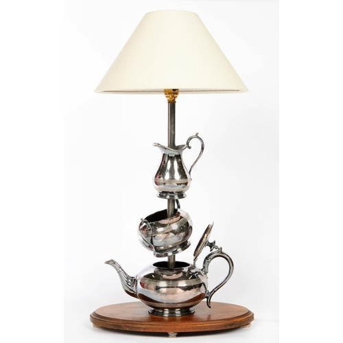 175 - <p>A TABLE LAMP INCORPORATING A THREE PIECE SILVER PLATED TEA SERVICE, WITH LAMPSHADE, 64CM H OVERAL...
