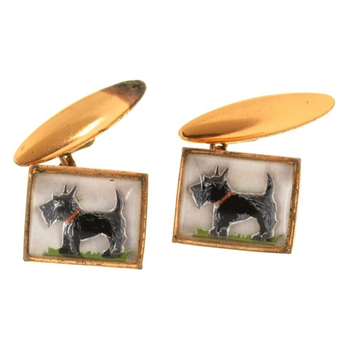192 - <p>COSTUME JEWELLERY.  A PAIR OF TERRIER NOVELTY CUFF-LINKS IN IN THE MANNER OF 19TH C REVERSE PAINT...