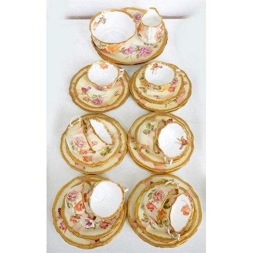 207 - <p>A HAMMERSLEY WORCESTER-STYLE TEA SERVICE, DECORATED WITH ROSES ON A SHADED APRICOT GROUND, C1900<...