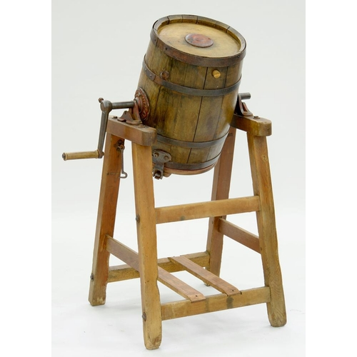 226 - <p>A WOODEN BUTTER CHURN WITH IRON HOOPS ON PINE STAND BY WAIDE & SONS LTD LEEDS, 11CM H, EARLY 20TH...