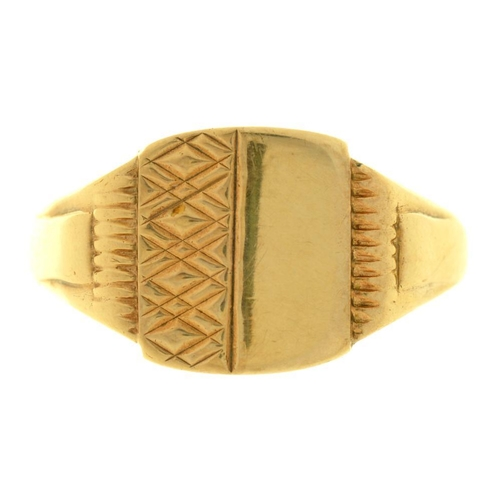 23 - <p>AN ENGRAVED 9CT GOLD SIGNET RING, 5G, SIZE X</p><p></p>...