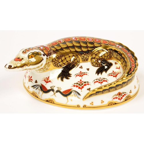 235 - <p>A ROYAL CROWN DERBY CROCODILE PAPERWEIGHT, 15CM L, PRINTED MARK, GILT STOPPER</p>...