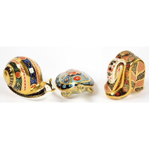 251 - <p>THREE ROYAL CROWN DERBY PAPERWEIGHTS, COMPRISING GARDEN SNAIL, SNAKE AND TERRAPIN, PRINTED MARKS,...