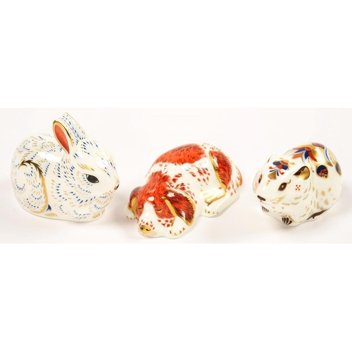 255 - <p>THREE ROYAL CROWN DERBY COLLECTOR'S GUILD PAPERWEIGHTS, COMPRISING PUPPY, BANK VOLE AND BUNNY, PR...