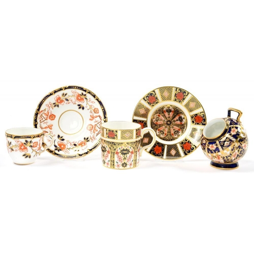 257 - <p>A ROYAL CROWN DERBY IMARI PATTERN COFFEE CAN AND SAUCER, A SALT PIG AND A PATTERN 6479 TEACUP AND...