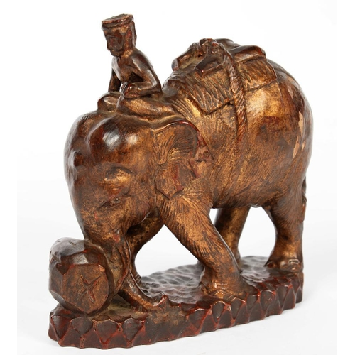 293 - <p>A BURMESE CARVED AND GILDED MODEL OF AN ELEPHANT AND MAHOUT, 20CM H, EARLY 20TH C</p>...