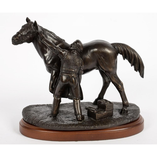 299 - <p>A BRONZED RESIN SCULPTURE OF A FARRIER AND HORSE, 13CM H</p>...