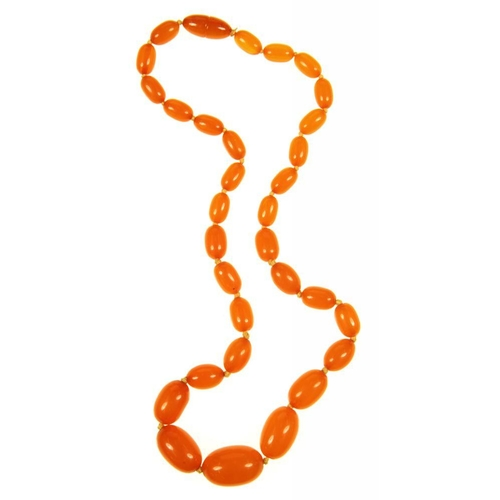 38 - <p>A BUTTERSCOTCH AMBER BEAD NECKLACE, OF THIRTY ONE OLIVE SHAPED BEADS GRADUATING FROM APPROXIMATEL...
