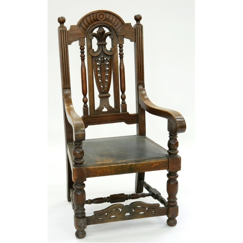 535 - <p>AN OAK ELBOW CHAIR WITH CARVED VASE SPLAT AND BREAK ARCHED CREST RAIL, 126CM H, EARLY 20TH C</p>...