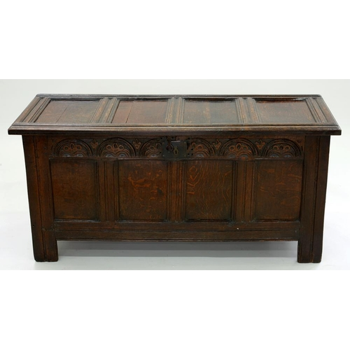 548 - <p>AN OAK CHEST WITH FOUR PANEL LID AND FRONT, LUNETTE CARVED APRON AND IRON LOCK PLATE, ON CHANNELL...
