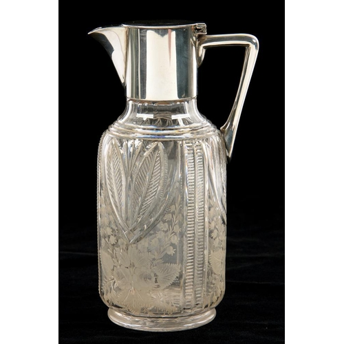 148 - <p>A LATE VICTORIAN EPNS MOUNTED GLASS CLARET JUG BY HUKIN AND HEATH, THE BODY CUT AND ENGRAVED WITH...