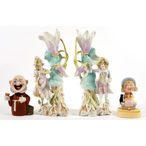 175 - <p>TWO CONTINENTAL BISCUIT PORCELAIN NODDING FIGURES AND A PAIR OF CONTINENTAL FIGURAL SPILL HOLDERS...