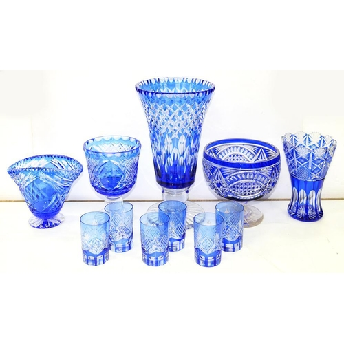 190 - <p>A COLLECTION OF BLUE FLASHED AND CUT GLASS WARE, COMPRISING FOUR VASES, PUNCH BOWL AND SET OF SIX...