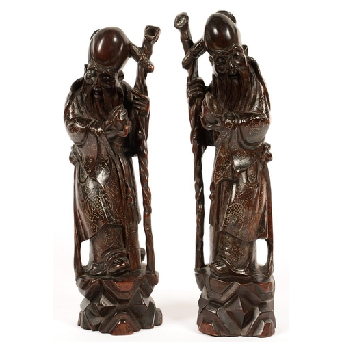 293 - <p>A PAIR OF CHINESE CARVED AND WIRE INLAID HARDWOOD FIGURES OF SHOU LAO, 37CM H, C1900</p>...
