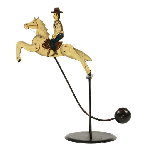 306 - <p>AN ANTIQUE STYLE PAINTED METAL BUCKING BRONCO PENDULUM MOBILE, APPROXIMATELY 45CM H INCLUDING STA...