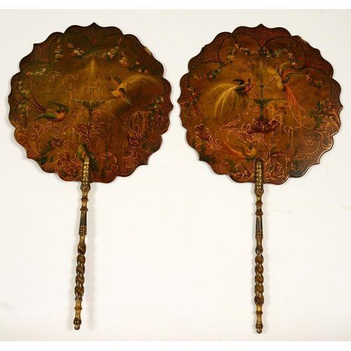 309 - <p>A PAIR OF VICTORIAN PAPIER MACHE HAND SCREENS, PAINTED WITH BIRDS AND A FOUNTAIN, SPIRAL TURNED G...