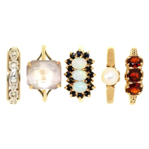 32 - <p>FIVE GEM SET GOLD RINGS, INCLUDING A THREE STONE GARNET RING, AND A THREE STONE OPAL AND SAPPHIRE...
