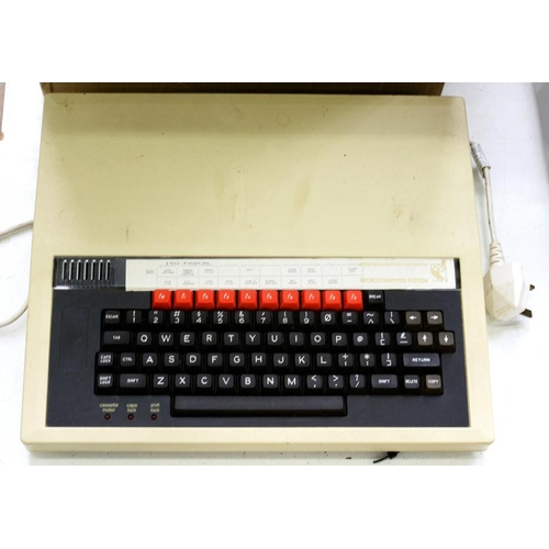 391 - <p>A BBC MICROCOMPUTER, INCLUDING KEYBOARD, DISC DRIVE, DISCS AND ACCESSORIES, C1980'S</p>...