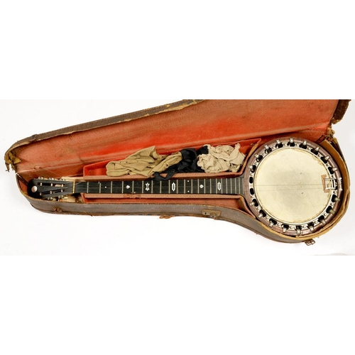 421 - <p>MUSICAL INSTRUMENTS. AN EARLY 20TH C ROSEWOOD BANJO, INLAID WITH MOTHER OF PEARL WITH TONE CHAMBE...