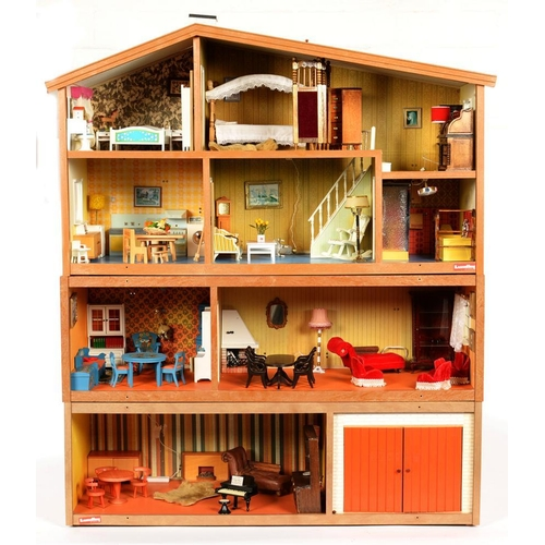 423 - <p>A FOUR STOREY DOLL'S HOUSE BY LUNDBY OF SWEDEN, WITH EXTENSIVE COLLECTION OF FURNITURE AND FITTIN...