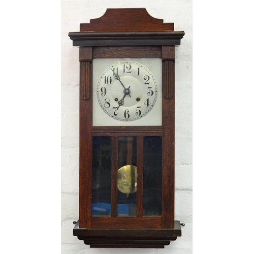 426 - <p>A STAINED OAK WALL CLOCK WITH SILVERED DIAL, C1930, 76 X 35CM </p>...