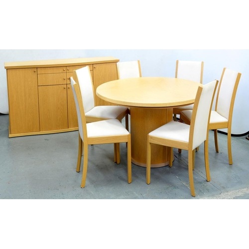 579 - <p>A SKOVBY EIGHT PIECE OAK DINING SUITE, COMPRISING SIX CHAIRS, DINING TABLE, 120CM D AND A BOW FRO...