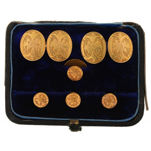 73 - <p>A PAIR OF FOLIATE ENGRAVED GOLD CUFFLINKS, LATE 19TH C, AND MATCHING GOLD DRESS STUDS, CASED, 9G<...