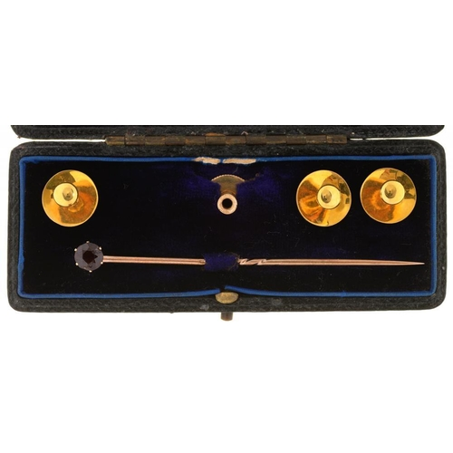 75 - <p>THREE 18CT GOLD DRESS STUDS, A FURTHER GOLD DRESS STUD AND A GARNET STICK PIN IN GOLD, CASED, 5.5...