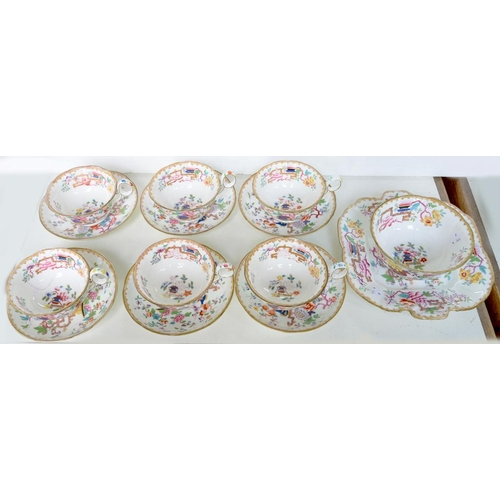 223 - <p>A STAFFORDSHIRE PORCELAIN CHINESE ROSE PATTERN TEA SERVICE, COMPRISING SIX CUPS AND SAUCERS, SLOP...