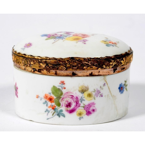 231 - <p>A GERMAN PORCELAIN OVAL COPPER GILT MOUNTED SNUFF BOX AND DOMED LID, PAINTED WITH SCATTERED FLOWE...