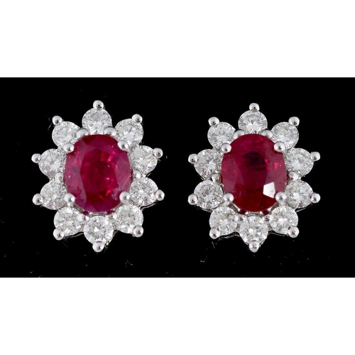 36 - <p>A PAIR OF RUBY AND DIAMOND CLUSTER EARRINGS IN WHITE GOLD, MARKED 750, 3.9G</p>...