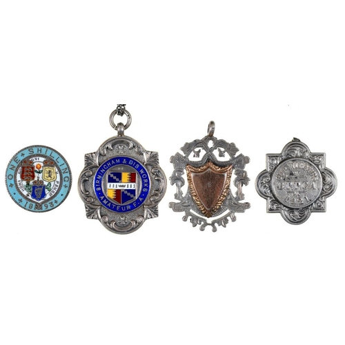 41 - <p>A SILVER AND ENAMEL SPORTSMAN'S WATCH FOB SHIELD, BIRMINGHAM 1925, TWO OTHER CONTEMPORARY SILVER ...
