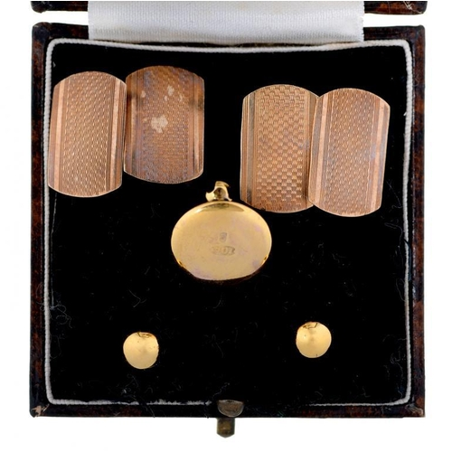 48 - <p>A PAIR OF GOLD CUFFLINKS, ENGINE TURNED, MARKED 9CT AND A CASED SET OF THREE GOLD DRESS STUDS, MA...