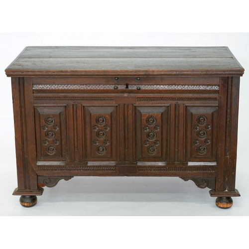 524 - <p>A CONTINENTAL CARVED OAK CHEST, WITH PANELLED FRONT AND SIDES, 18TH C, 116CM W</p>...
