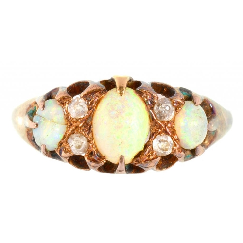 104 - <p>AN OPAL AND DIAMOND RING, IN GOLD MARKED 18CT, 2.8G</p>...
