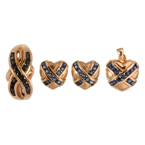106 - <p>A SAPPHIRE SET SUITE OF 9CT GOLD JEWELLERY, COMPRISING CROSSOVER RING, PENDANT AND HEART SHAPED E...