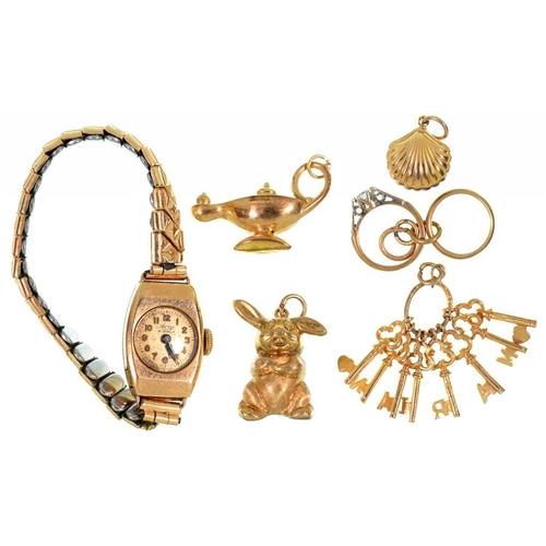 122 - <p>FIVE VARIOUS GOLD CHARMS, INCLUDING A RABBIT, 10.5G AND A GOLD LADY'S TONNEAU SHAPED WRISTWATCH O...