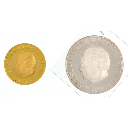 125 - <p>COMMEMORATIVE GOLD (.900) MEDAL. LIECHTENSTEIN 1978, 6.7G AND A LARGER SIMILAR SILVER COMMEMORATI...