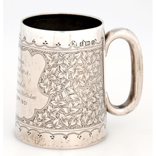 176 - <p>A VICTORIAN SILVER CHRISTENING MUG, ENGRAVED WITH A WIDE BAND OF LEAVES AND CONTEMPORARY INSCRIPT...