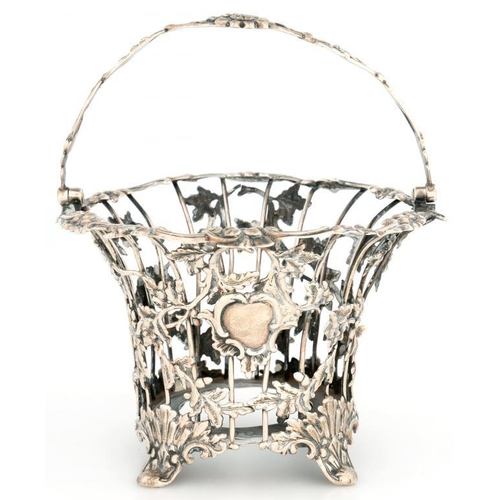 180 - <p>A VICTORIAN SILVER WIREWORK SUGAR BASKET, WITH SWING HANDLE, THE SIDES APPLIED WITH NATURALISTIC ...