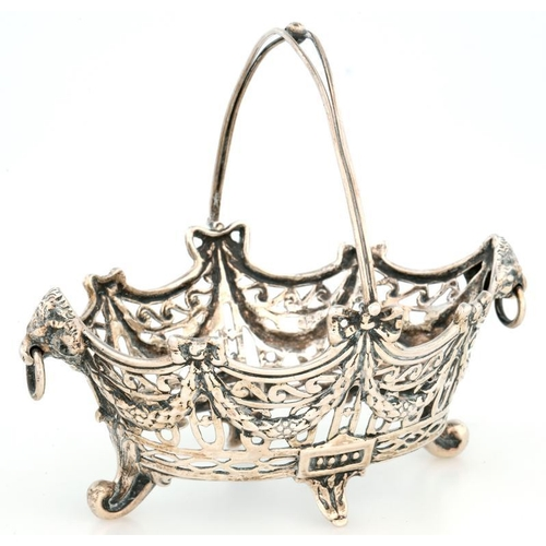 181 - <p>A GERMAN SILVER OPENWORK OVAL SWEETMEAT BASKET, DECORATED WITH FESTOONS AND SCROLLS, WITH CAST RA...